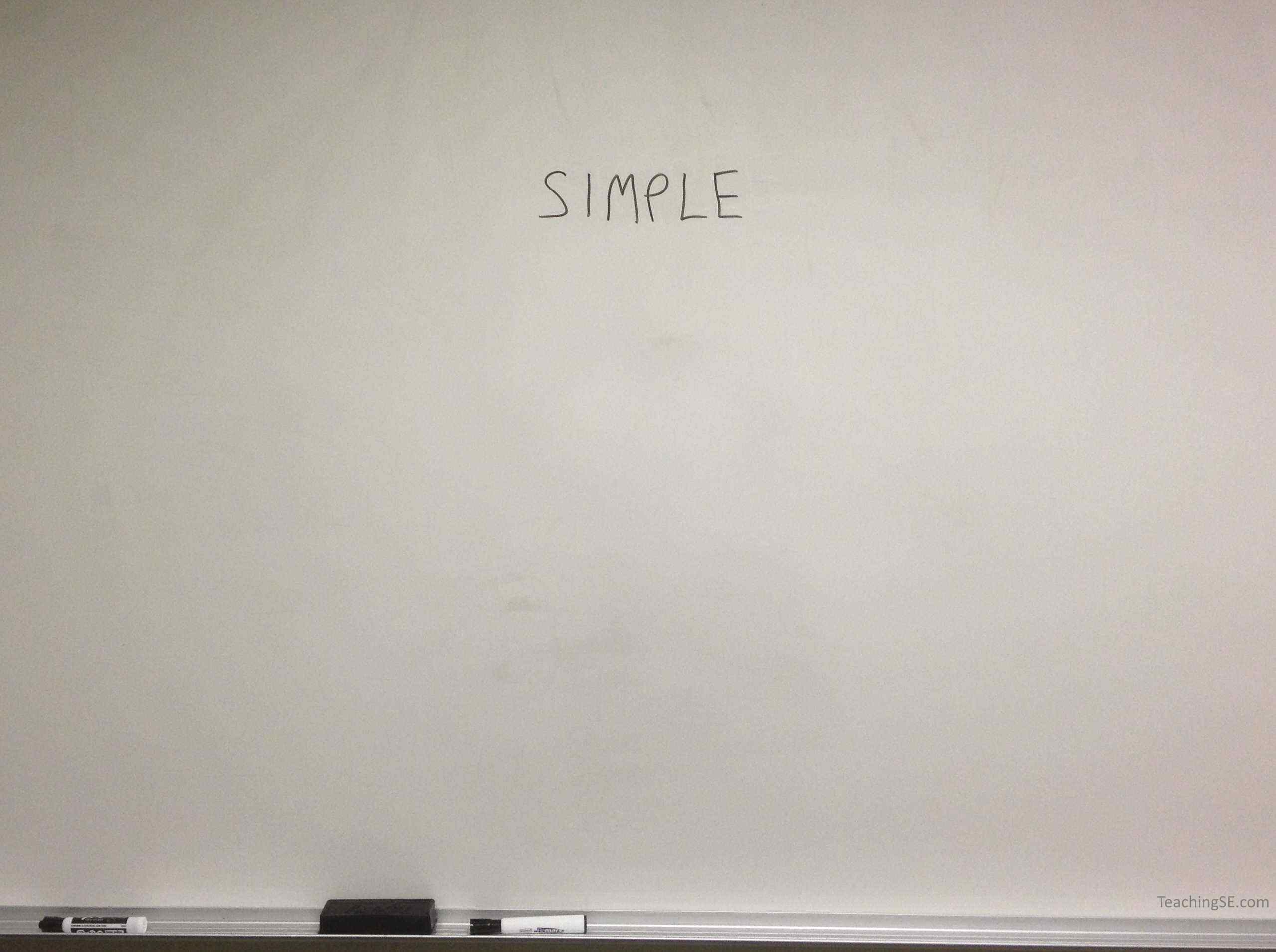 A blank whiteboard with the word 'Simplicity' written on it